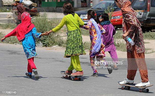 Young Afghan skateboarders take to the streets during an event held by the 'Skateistan' NGO in Kabul on June 21 2011 The Afghan Skate School...