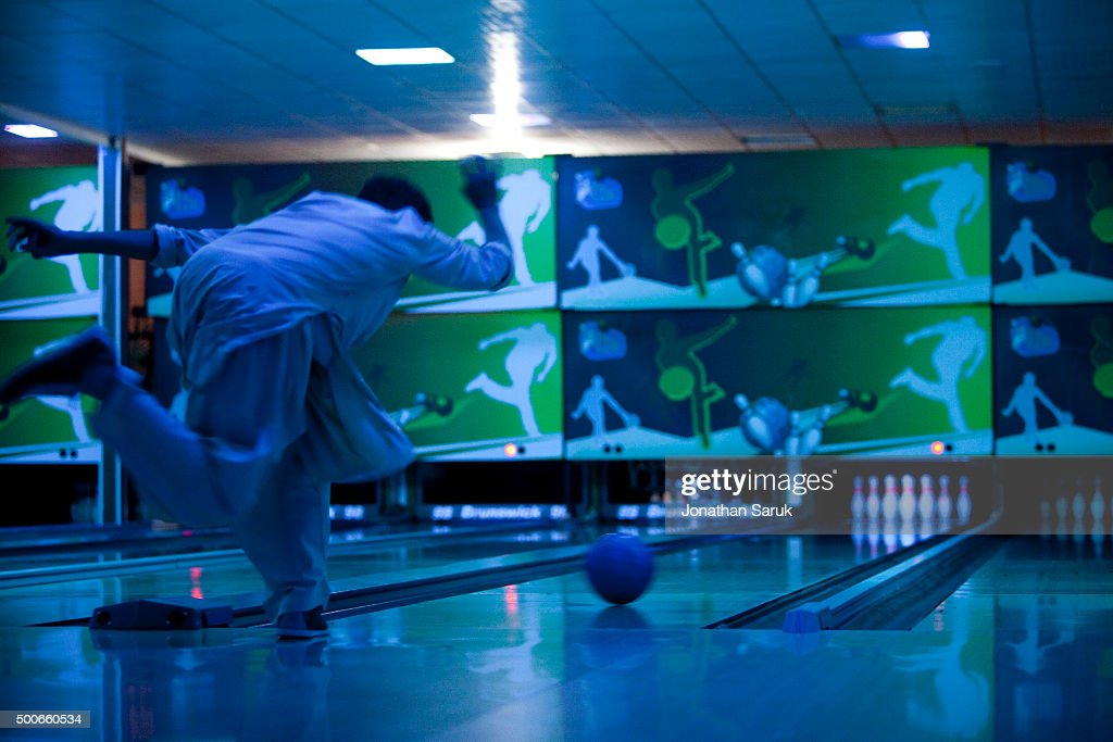 Young afghans bowling at The Strikers, Afghanistan's first bowling alley September 30, 2011 in Kabul, Afghanistan. The Afghan owned bowling alley opened this month after 8 months of construction.