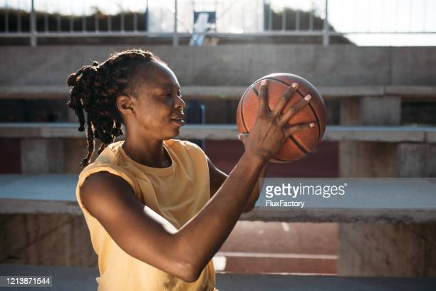 young african american athlete playing basketball - basketball player stock pictures, royalty-free photos & images