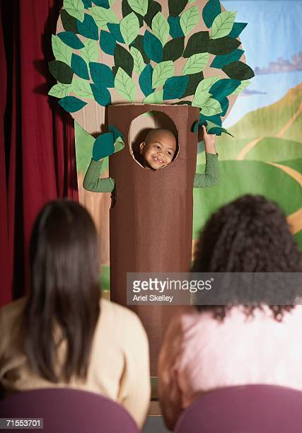 young african american boy in tree costume on stage - acting performance stock pictures, royalty-free photos & images