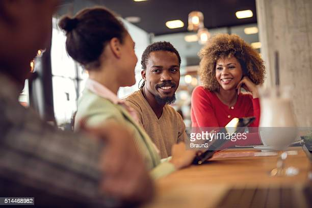 Young African American business team talking on a meeting.