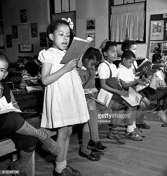 Young African American children attending a reading lesson in a segregated elementary school Washington DC March 1942