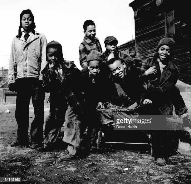Young African American children play in an unidentified slum neighborhood of Chicago 1952
