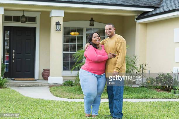 young african american couple outside home - images of fat black women stock photos and pictures