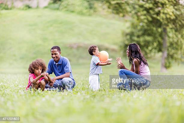 Young African American family having fun in the park.