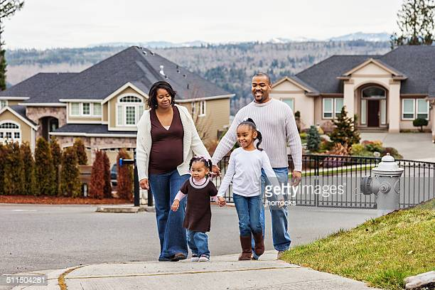 Young African American Family Taking a Stroll in the Neighborhood