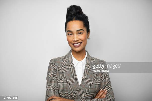 young african american female entrepreneur with arms crossed - black blazer stock pictures, royalty-free photos & images