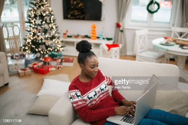 young african american female student working from home - coronavirus winter stock pictures, royalty-free photos & images