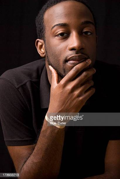 young african american male on black background - handsome black boy stock photos and pictures