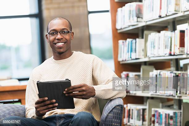 Young African American man in the library
