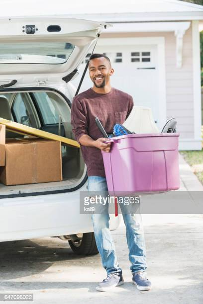 Young African American man moving house