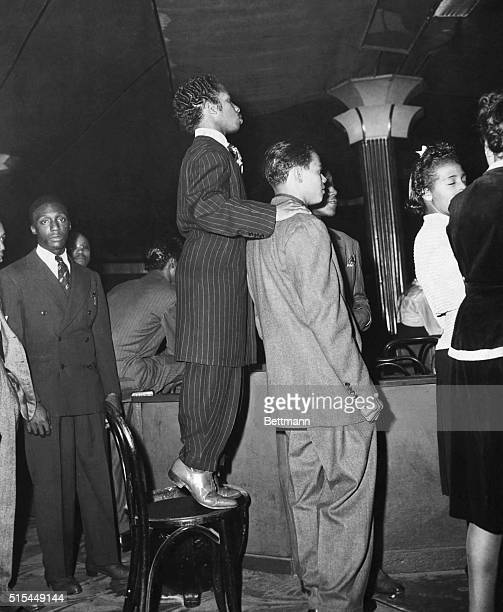 Young African American men in zoot suits at the Savoy Ballroom in Harlem Photograph 1930's
