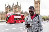 Young African American runner on Westminster bridge