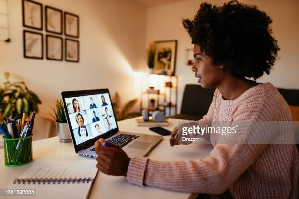 young african american woman at home - debate stock pictures, royalty-free photos & images