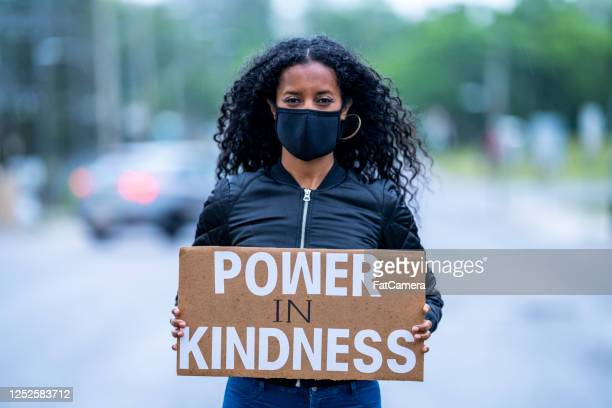 young african american woman holding protest sign - protest against violence against women stock pictures, royalty-free photos & images