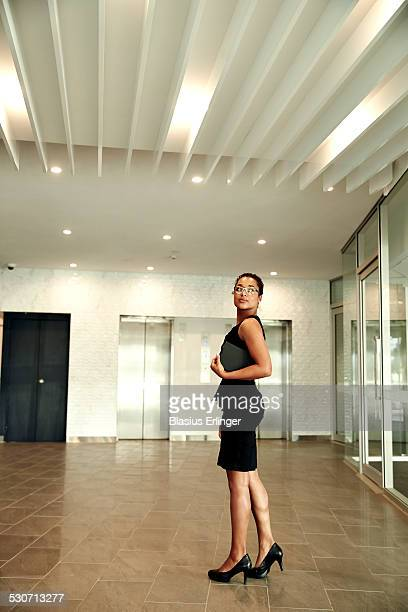 Young African American woman in black dress