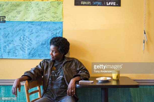 Young African American woman in cafe