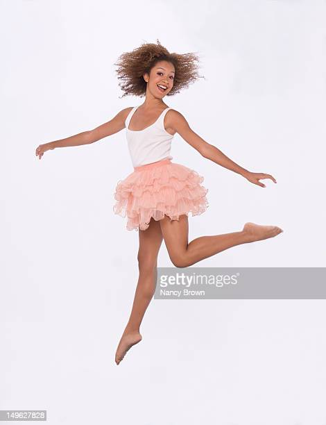 Young African American woman jumping.