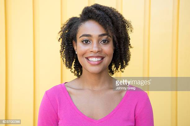 Young African American woman smiling towards the camera