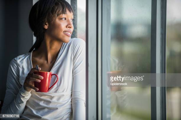 Young African American Woman with Coffee