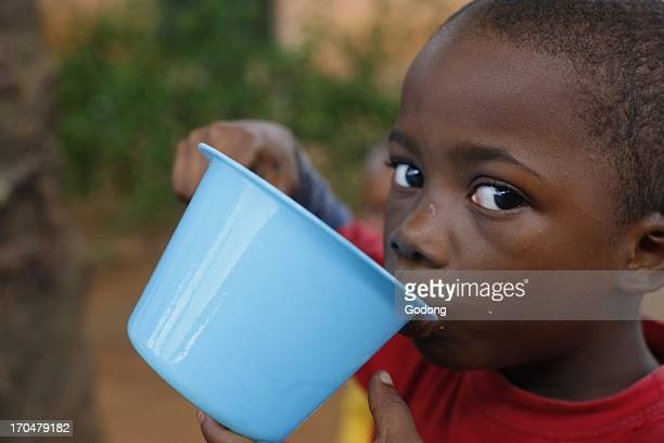 Young african boy drinking water Lome Togo