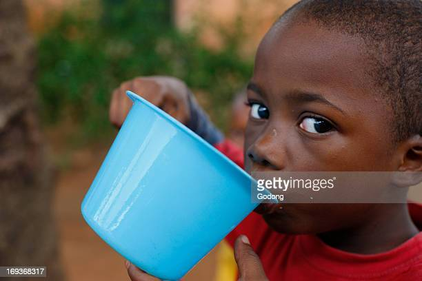 Young african boy drinking water Togo