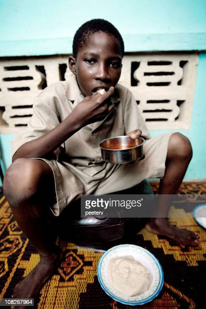 young african boy eating - nigerian food stock pictures, royalty-free photos & images