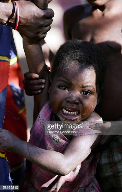 A young African boy who has lost his parents though Aids cries on July 1 2005 in Mozambique Since Mozambique's 15year civil war ended in 1992 the...