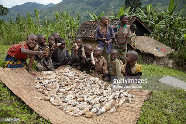 young african boys with roots - burundi fotografías e imágenes de stock