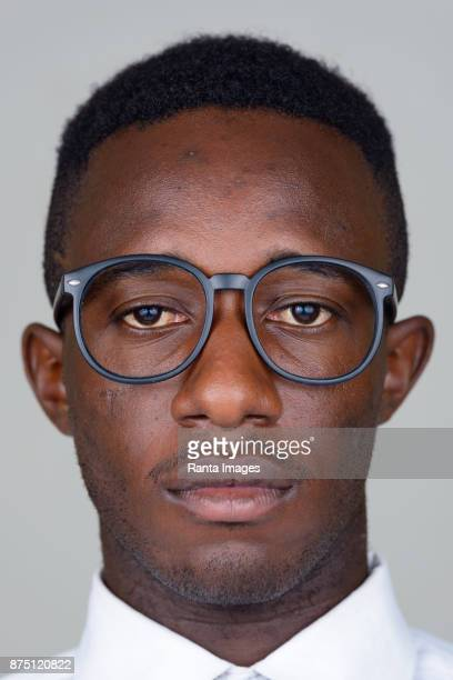 young african businessman wearing eyeglasses against white background - thick rimmed spectacles stock photos and pictures