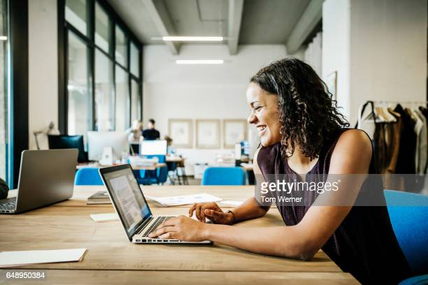 Young african businesswoman working on laptop