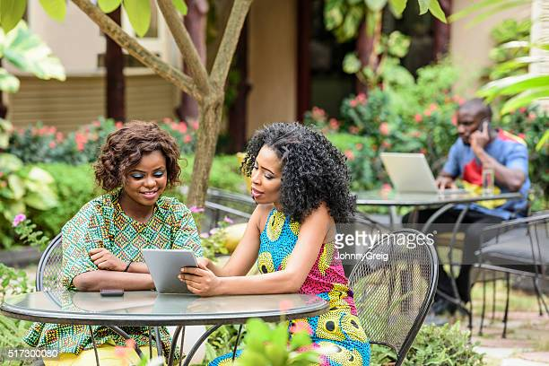 Young African businesswomen using digital tablet