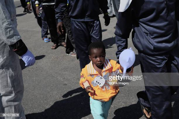A young African child seen walking as about 1500 african refugees land in Naples from Vos Prudence a rescue boat of Medecins Sans Frontieres On May...