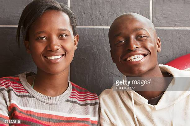 young african couple smiling - native african girls stock photos and pictures