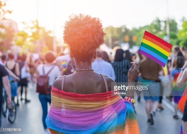 young african ethnicity woman at the love festival - gay rights stock pictures, royalty-free photos & images