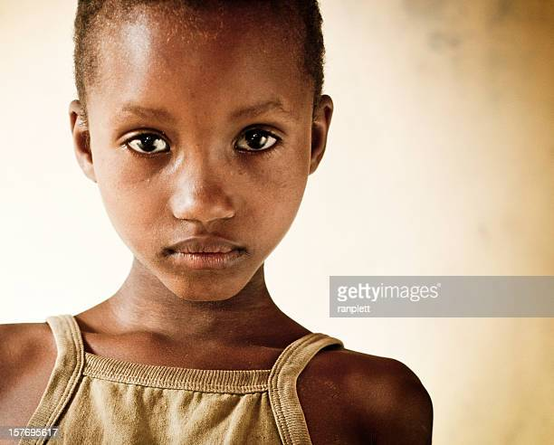 young african girl in an orphanage - armoede stockfoto's en -beelden