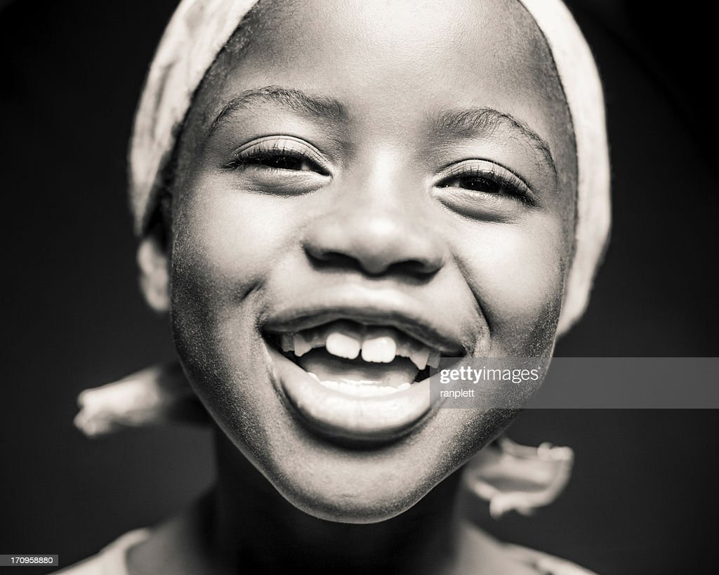 Young African Girl Laughing (Isolated on Black) : Stock Photo