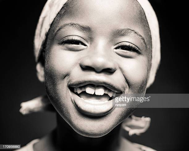 Young African Girl Laughing (Isolated on Black)