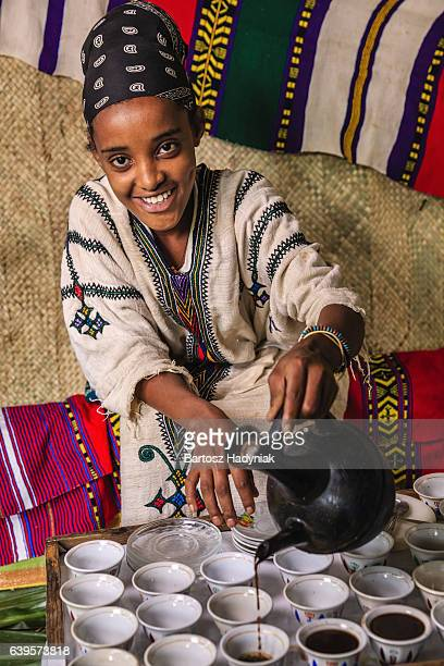Young African girl preparing coffee, Ethiopia. East Africa