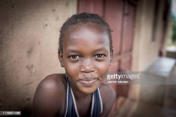 young african girl smiling - native african girls stock pictures, royalty-free photos & images