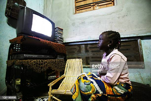 young african girl watching television - native african girls stock photos and pictures