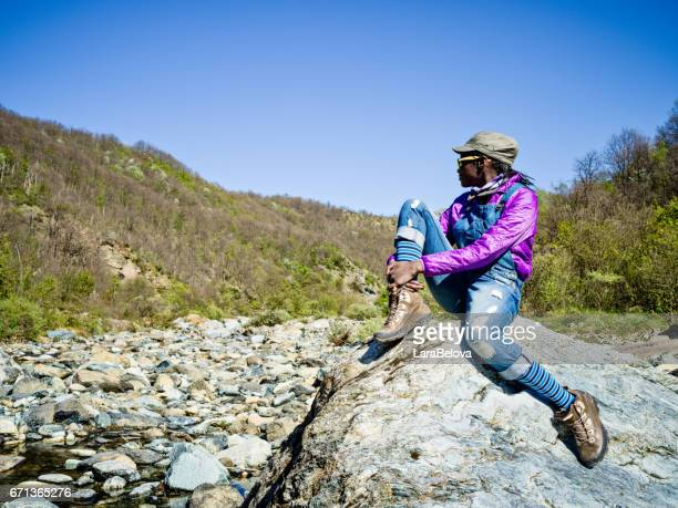 young african hiking woman - san antonio river walk stock photos and pictures