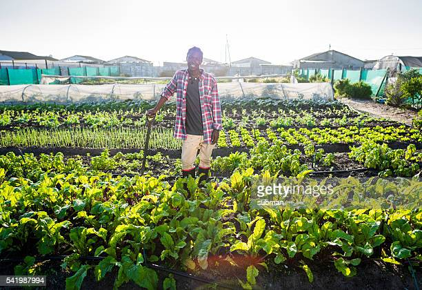 Young African male smiling in his vegetable garden