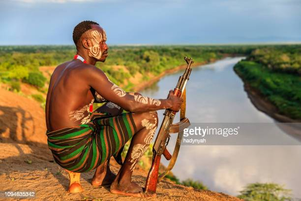 young african man from karo tribe, east africa - horn of africa stock pictures, royalty-free photos & images