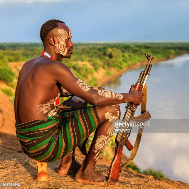 young african man from karo tribe, east africa - ak 47 stock photos and pictures