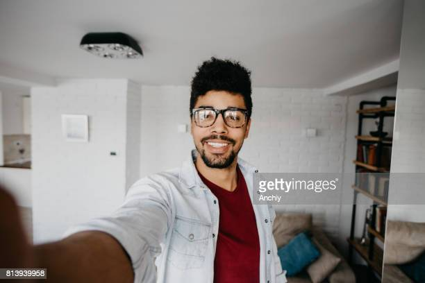 young african man is taking selfie - self portrait stock pictures, royalty-free photos & images