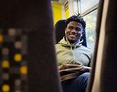 train listening to music headphones