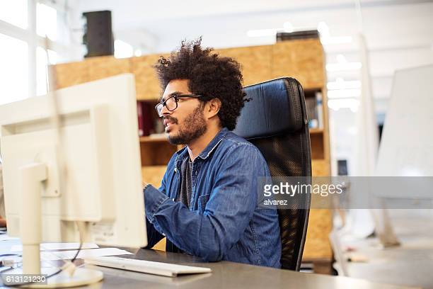 Young african man working at his desk