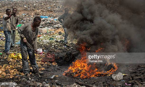 Young African men burn electronic waste on the biggest electronic scrap yard of Africa in Agbogbloshie a district of the Ghanaian capital Disused...