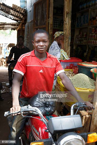 Young African on a motorcycle on the market in Niamey on August 10 2016 in Niamey Niger